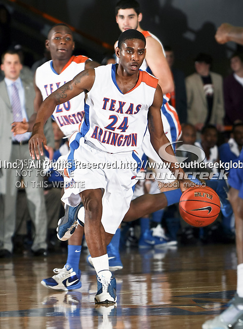 Texas-Arlington Mavericks guard Bryant Smith (24) brings the ball down court in the game between the Texas A&M- Corpus Christi Islanders and the University of Texas-Arlington Mavericks held at the University of Texas in Arlington's Texas Hall in Arlington, Texas. UTA defeats Texas A&M- Corpus Christi 70 to 49..