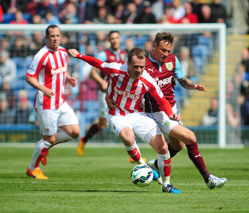 Stoke City's Glenn Whelan vies for possession with  Burnley's Matthew Taylor<br /> <br /> Photographer Andrew Vaughan/CameraSport<br /> <br /> Football - Barclays Premiership - Burnley v Stoke City - Saturday 16th May 2015 - Turf Moor - Burnley<br /> <br /> &copy; CameraSport - 43 Linden Ave. Countesthorpe. Leicester. England. LE8 5PG - Tel: +44 (0) 116 277 4147 - admin@camerasport.com - www.camerasport.com