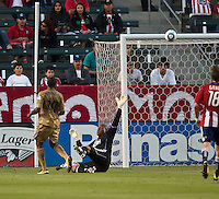 Chivas USA goalie Zach Thornton (22) attempts to block the goal kick from Philadelphia Union forward Danny Mwanga (10) during the first half of the game between Chivas USA and the Philadelphia Union at the Home Depot Center in Carson, CA, on July 3, 2010. Chivas USA 1, Philadelphia Union 1.