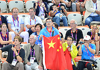 August 04, 2012..Member of the Chinese delegation watches anxiously final laps of Men's 1500m Freestyle Final at the Aquatics Center on day eight of 2012 Olympic Games in London, United Kingdom.