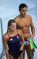 26 JUL 2012 - LONDON, GBR - Great Britain divers Tonia Couch (GBR) and Tom Daley (GBR) walk back to their coaches after finishing their practice sessions at the Aquatics Centre in the Olympic Park in Stratford, London, Great Britain ahead of the start of the London 2012 Olympic Games (PHOTO (C) 2012 NIGEL FARROW)