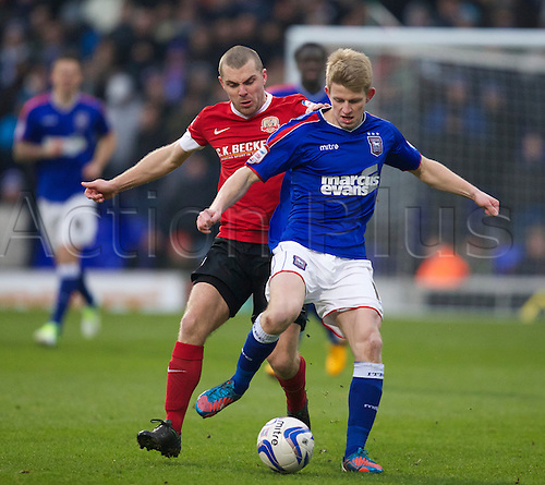 19.01.2013 Ipswich, England. Luke Hyam and Stephen Dawson  in action during the Championship game between Ipswich Town and Barnsley at Portman Road.