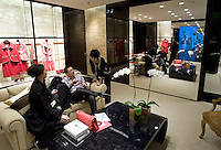 Customers in Chanel boutique in Peninsula hotel in Shanghai, on December 3, 2009. Chanel's Peninsula hotel boutique is the largest Chanel store in China and was opened on December 3. Photo by Lucas Schifres/Pictobank