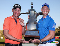 Danny Willett (ENG) with caddie Jon Smart, holds the Champion's Trophy and wins the Final Round of the 2016 Omega Dubai Desert Classic, played on the Emirates Golf Club, Dubai, United Arab Emirates.  07/02/2016. Picture: Golffile | David Lloyd<br /> <br /> All photos usage must carry mandatory copyright credit (&copy; Golffile | David Lloyd)