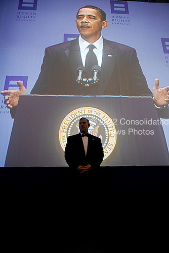 Washington, DC - October 10, 2009 -- A U.S. Secret Service agent stands post as United States President Barack Obama, projected on a screen, delivers remarks during the Human Rights Campaign dinner, at the Walter E. Washington Convention Center in Washington, D.C, October 10, 2009. .Mandatory Credit: Chuck Kennedy - White House via CNP