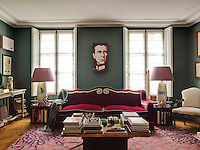 Between the windows in the drawing room, hangs a portrait of Manfred, Baron von Richthofen, the 'Red Baron', by Paolo Facchinelli. The sofa was designed by Nicolo and the carpet by Federica Tondato