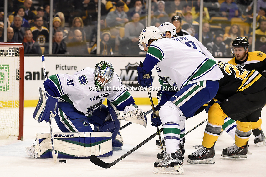 Thursday, January 21, 2016: Vancouver Canucks goalie Jacob Markstrom (25) makes a save during the National Hockey League game between the Vancouver Canucks and the Boston Bruins, held at TD Garden, in Boston, Massachusetts. Eric Canha/CSM