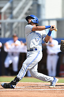 Angel Camacho (19) of the Bluefield Blue Jays follows through on his swing during a game against the Danville Braves at American Legion Post 325 Field on July 28, 2019 in Danville, Virginia. The Blue Jays defeated the Braves 9-7. (Tracy Proffitt/Four Seam Images)