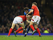 17th March 2018, Principality Stadium, Cardiff, Wales; NatWest Six Nations rugby, Wales versus France; Benjamin Fall of France is tackled by Hadleigh Parkes and Dan Biggar of Wales