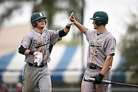 Slippery Rock Carson Kessler (17) high fives Ty Zimmerman (5) after scoring a run during a game against the University of the Sciences Devils on March 6, 2015 at Jack Russell Field in Clearwater, Florida.  Slippery Rock defeated University of the Sciences 6-3.  (Mike Janes/Four Seam Images)