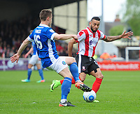 Lincoln City's Nathan Arnold vies for possession with Macclesfield Town's Mitch Hancox<br /> <br /> Photographer Chris Vaughan/CameraSport<br /> <br /> Vanarama National League - Lincoln City v Macclesfield Town - Saturday 22nd April 2017 - Sincil Bank - Lincoln<br /> <br /> World Copyright &copy; 2017 CameraSport. All rights reserved. 43 Linden Ave. Countesthorpe. Leicester. England. LE8 5PG - Tel: +44 (0) 116 277 4147 - admin@camerasport.com - www.camerasport.com
