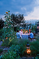 In the evening this herb garden provides the perfect setting for friends to have an al fresco dinner