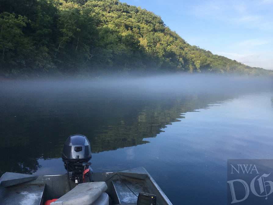 NWA Democrat-Gazette/FLIP PUTTHOFF<br /> Fog rolls across the water Friday, July 14, 2017 on the White river below beaver dam.