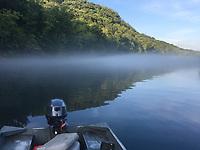 NWA Democrat-Gazette/FLIP PUTTHOFF<br /> Fog rolls across the water Friday, July 14, 2017 on the White river below beaver dam.