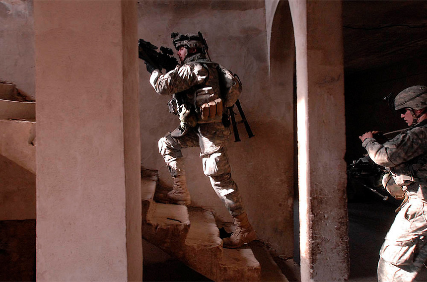 Soldiers with the 10th Mountain Division search a home in  Mufarji Village near Yusifiyah, Iraq.