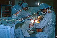 Surgeons performing heart transplant surgery in a hospital operating theatre. The surgeon is performing a procedure called stripping. This is the removal of the long and short saphenous veins of the leg. This image may only be used to portray the subject in a positive manner..©shoutpictures.com..john@shoutpictures.com