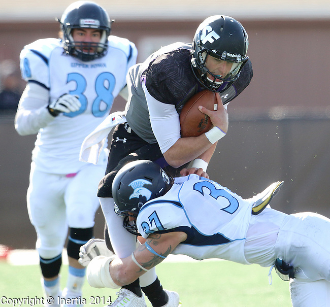 SIOUX FALLS, SD - NOVEMBER 8: Luke Papilion #15 from the University of Sioux Falls is brought down by Derek Olson #37 from Upper Iowa in the second quarter of their game Saturday afternoon at Bob Young Field in Sioux Falls.  (Photo by Dave Eggen/Inertia)