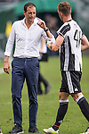 Juventus' head coach Massimiliano Allegri talks with Juventus' player Lorenzo Rosseti during the South China vs Juventus match of the AET International Challenge Cup on 30 July 2016 at Hong Kong Stadium, in Hong Kong, China.  Photo by Marcio Machado / Power Sport Images