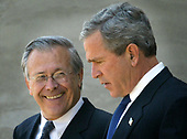 United States President George W. Bush, right, and US Secretary of Defense Donald Rumsfeld, left, walk outside the Pentagon after a classified briefing May 10, 2004. Bush's trip to the Pentagon was scheduled before the Abu Ghraib prisoner abuse scandal made headlines.  <br /> Credit: Mark Wilson / Pool via CNP