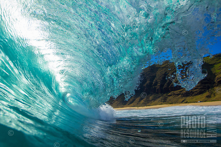 Inside the tube of a perfect wave breaking on the North Shore, O'ahu.