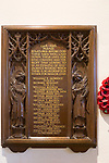 Elaborately carved wooden Arts and Crafts First World War 1914-1918 memorial, All Saints church, Lydiard Millicent, Wiltshire, England, UK