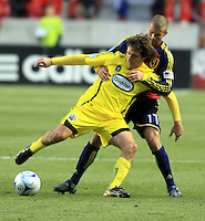 Guillermo Barros Schelotto (front) and Chris Wingert (back) in the Columbus Crew vs Real Salt Lake 1-4 RSL win at Rio Tinto Stadium in Sandy, Utah on April 2, 2009.