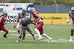 Kyle Sweet (83) drops a stiff-arm on Deion Singleton (39) during the annual Washington State Cougar spring game, the Crimson and Gray game, at Joe Albi Stadium in Spokane, Washington, on April 23, 2016.