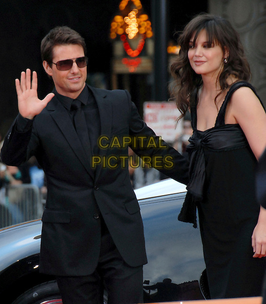 TOM CRUISE & KATIE HOLMES .Paramount Pictures' Fan Screening of Mission: Impossible III held at The Grauman's Chinese Theatre in Hollywood, California, USA..May 4th, 2006.Ref: DVS.half length suit jacket celebrity couple hand waving palm black dress.www.capitalpictures.com.sales@capitalpictures.com.Supplied By Capital PIctures