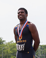 Smiling, John Burroughs senior Ezekiel Elliott stands atop the awards podium after winning the Class 3 200-meter dash title, his fourth title in 2 hours and 35 minutes at the 2013 Missouri High School State Track and Field Championships. Elliott claimed the 110-meter hurdles, 100-meter dash, 300-meter hurdles, and 200-meter dash, earning 40 team points of the Bombers 55.5 points for second-place, just 2.5 points behind champion Grandview. The performance and season Elliott had earned him the Gatorade Missouri Track and Field Athlete of the Year honor.