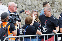 Pictured: The parents of Gareth Thomas Yvonne (C with the back to the camera), Barry (L) and husband Stephen (R). Sunday 15 September 2019<br /> Re: Ironman triathlon event in Tenby, Wales, UK.