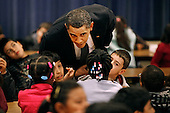 Silver Spring, MD - October 19, 2009 -- United States President Barack Obama asks third and fourth graders what they are reading during their lunch period at Viers Mill Elementary School, Monday, October 19, 2009 in Silver Spring, Maryland. The elementary school was named a 2005 National Title I No Child Left Behind Blue Ribbon school. .Credit: Chip Somodevilla / Pool via CNP