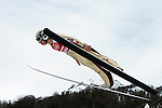 Coline Mattel of France jumps during the Women's Normal Hill Individual training session of the 2014 Sochi Olympic Winter Games at Russki Gorki Ski Juming Center on February 9, 2014 in Sochi, Russia. Photo by Victor Fraile / Power Sport Images
