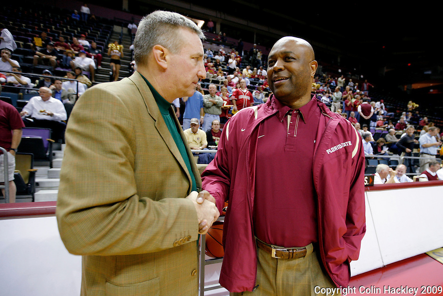 TALLAHASSEE, FL 11/3/09-FSU-DELTA BB09 CH01-Florida State Head Coach Leonard Hamilton, right, talks with Delta State Head Coach Jason Conner prior to the game Tuesday at the Tallahassee-Leon County Civic The Seminoles beat the Statesmen 81-38 in their first exhibition game of the season...COLIN HACKLEY PHOTO