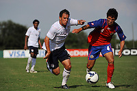 Danny Cruz (7) of the USA and Juan Andres Monge (4) of Costa Rica. The US U-20 Men's National Team defeated the U-20 Men's National Team of Costa Rica 2-1 in an international friendly during day four of the US Soccer Development Academy  Spring Showcase in Sarasota, FL, on May 25, 2009.