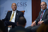 Washington, DC - October 9, 2014: U.S. Secretary of Homeland Security, Jeh Johnson (l), listens to an audience question about border security and immigration at the Center for Strategic and International Studies in the District of Columbia, October 9, 2014, as CSIS Senior Advisor Juan Zarate looks on.  (Photo by Don Baxter/Media Images International)