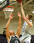 SIOUX FALLS, SD - DECEMBER 8:  Drew Guebert #23 from the University of Sioux Falls lays the ball up over Joey Bartlett #15 from Southwest Minnesota State Tuesday night at the Stewart Center. (Photo by Dave Eggen/Inertia)