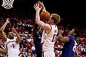 23 February 2011: Brandon Ubel #13 of the Nebraska Cornhuskers  gets hit in the face going for the rebound against Martavious Irving #3 of the Kansas State Wildcats during the second half at the Devaney Sports Center in Lincoln, Nebraska. Kansas State defeated Nebraska 61 to 57.