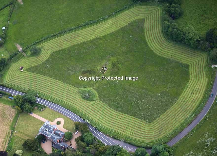 30/06/15<br /> <br /> Aerial view showing a tractor making hay on a hot summer's evening near Ashbourne, Derbyshire.<br /> <br /> All Rights Reserved: F Stop Press Ltd. +44(0)1335 418629   www.fstoppress.com.