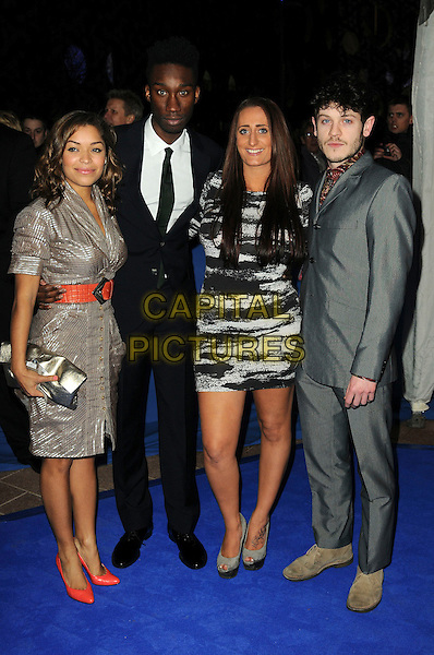 ANTONIA THOMAS, NATHAN STEWART-JARRETT, LAUREN SOCHA & IWAN REHON of 'Misfits'.Attending the British Comedy Awards 2011 at Indigo, The O2 Arena, London.England, UK, January 22nd, 2011..arrivals full length cast grey gray black suit dress red belt clutch bag shoes shirt gold print .CAP/CAS.©Bob Cass/Capital Pictures.