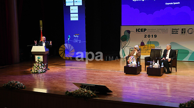 Palestinian Prime Minister Mohammad Ishtayeh speaks in the International Conference on empowerment in Palestine in the West Bank city of Ramallah, September 17 2019. Photo by Prime Minister Office