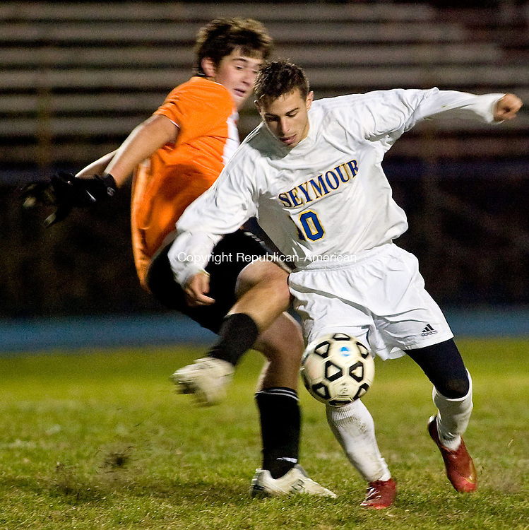 SEYMOUR, CT - 23 OCTOBER 2008 -102308JT10--<br /> Watertown's Billy O'Brien tries to kick the ball away from Seymour's Seth Ragaini as he dribbles toward goal during Thursday's game at Seymour. Seymour won, 1-0.<br /> Josalee Thrift / Republican-American
