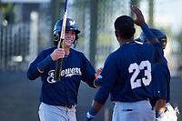 AZL Brewers Blue Cam Devanney (2) is congratulated by Arbert Cipion (23) after scoring a run during an Arizona League game against the AZL Royals at Surprise Stadium on June 18, 2019 in Surprise, Arizona. AZL Royals defeated AZL Brewers Blue 12-7. (Zachary Lucy/Four Seam Images)
