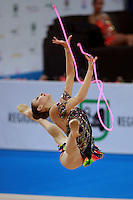 Evgeniya Kanaeva of Russia split leaps with rope at 2009 Pesaro World Cup on May 2, 2009 at Pesaro, Italy.  Photo by Tom Theobald.