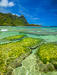 Kauai, Hawaii: Makana peak and high clouds, from the turquoise waters and green reefs of Tunnels Beach at Ha'ena
