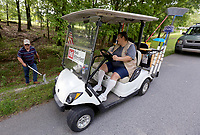 Tom and Kathy Baker, campground cleaning attendants at the U.S. Army Corps of Engineers' Prairie Creek Campground on Beaver Lake, pick up trash Wednesday, May 20, 2020, along the roadway at the park in Rogers. Wednesday was the first day that all U.S. Army Corps of Engineers campgrounds at Beaver Lake were opened because of covid-19 pandemic. Day use areas including swimming will open on Friday. Check out nwaonline.com/200521Daily/ and nwadg.com/photos for a photo gallery.<br /> (NWA Democrat-Gazette/David Gottschalk)