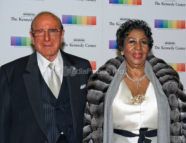 Clive Davis and Aretha Franklin arrive for the formal Artist's Dinner honoring the recipients of the 38th Annual Kennedy Center Honors hosted by United States Secretary of State John F. Kerry at the U.S. Department of State in Washington, D.C. on Saturday, December 5, 2015. The 2015 honorees are: singer-songwriter Carole King, filmmaker George Lucas, actress and singer Rita Moreno, conductor Seiji Ozawa, and actress and Broadway star Cicely Tyson.<br /> Credit: Ron Sachs / Pool via CNP/MediaPunch