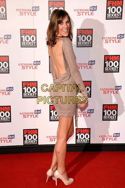 VERITY RUSHWORTH.The FHM 100 Sexiest Women for 2011 party, One Marylebone Rd., London, England..May 4th, 2011.full length dress beige shoes dress long sleeves backless looking over shoulder .CAP/PL.©Phil Loftus/Capital Pictures.