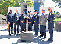 (left to right) Huntington Beach police officer, Corwin Bales, Mayor Jim Katapodis, NY Port Authority officer, Vincent Zappulla, Jr., New York Port Authority Detective Frank Accardi, Port Authority Captain Kevin Devlin, Port Authority officer, Robert Egbert and Huntington Beach officer, Jack Paholski stand in front of the new 9/11 Memorial located at Huntington Beach city hall.<br /> <br /> ///ADDITIONAL INFORMATION: hb.0915.memorial &ndash; 9/11/16 &ndash; MICHAEL KITADA, ORANGE COUNTY REGISTER - _DSC8518.jpg - <br /> Summary: The Huntington Beach Police Officers' Foundation's 9-11 Memorial Committee unveils a $200,000 monument including steel from the toppled World Trade Center, at City Hall. The event will include music, a flyover, New York police and others with connections to the 9-11 rescue and victims of the tragedy.