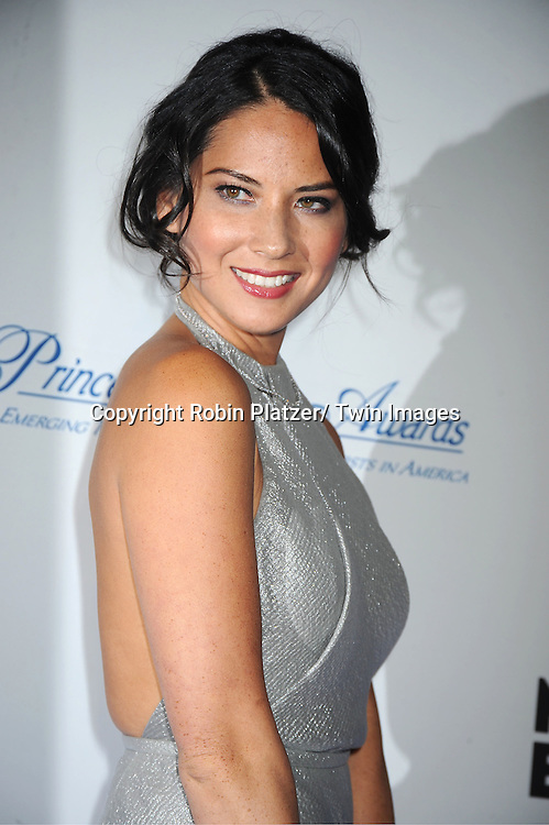 Olivia Munn in Calvin Klein silver dress  attends The Princess Grace Foundation Awards Gala on ..November 1, 2011 at Cipriani 42nd Street in New York City.