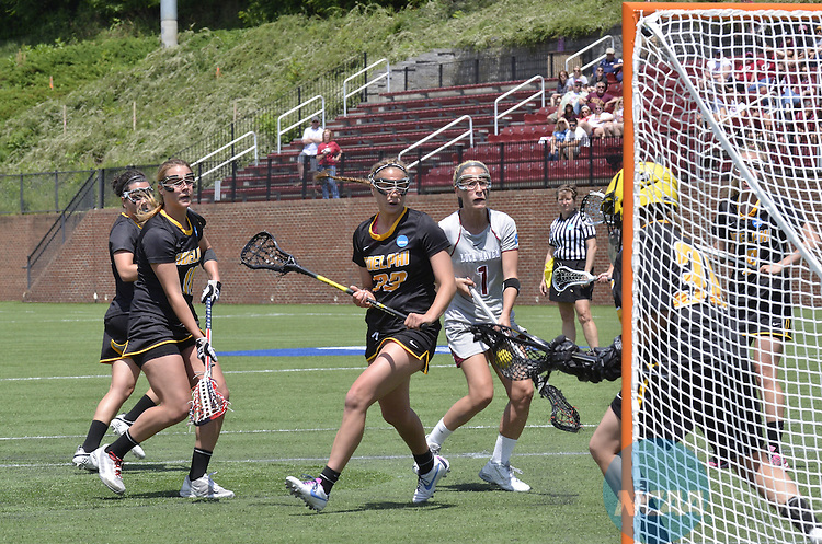 18 MAY 2014: Adelphi University GK Morgan Bare (30) stops a goal shot at the Division II Women's Lacrosse Championship held at Kerr Stadium in Salem, VA.  Adelphi defeated Lock Haven 7-5 to win the national title.  Andres Alonso/NCAA Photos